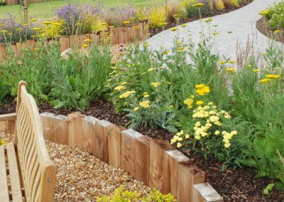 vibrant planting brightens british garden